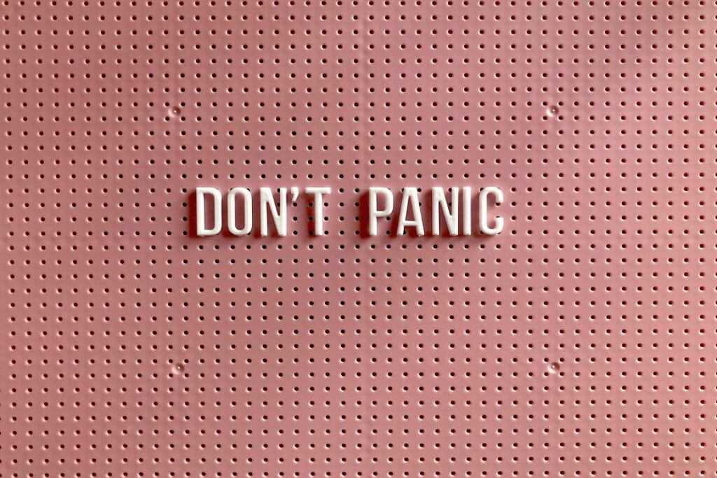 pink-board-that-says-don't-panic