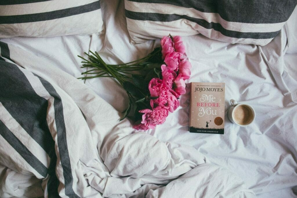 flowers and book on a bed