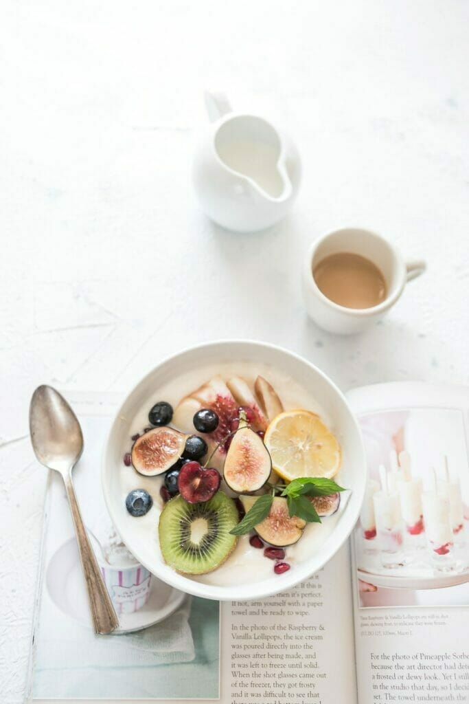 bowl of fruit and coffee cup