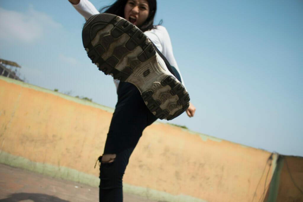 girl kicking her foot at the camera